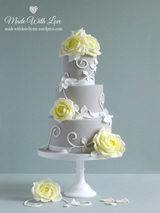 White Wedding Cake With Yellow Roses