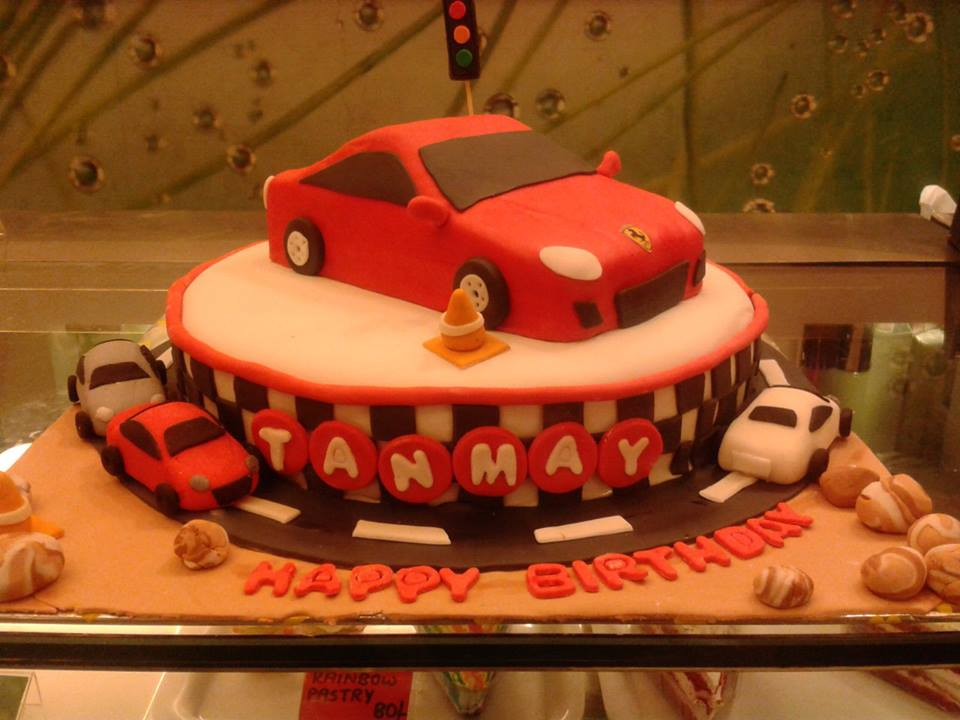 9 Cupcakes Shaped Into Cars Photo Race Car Cupcake Cake Cars