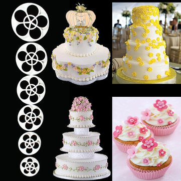 6 Photos of Plum Fondant Cupcakes