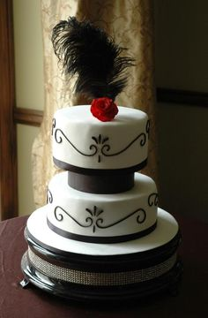 Red and Black Cakes with Feathers Pictures