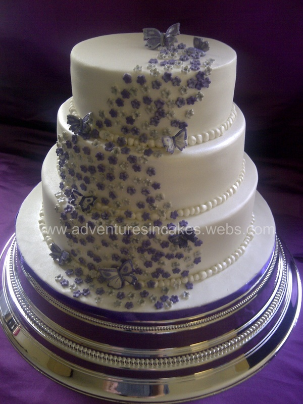 Purple and Silver Wedding Cakes with Flowers