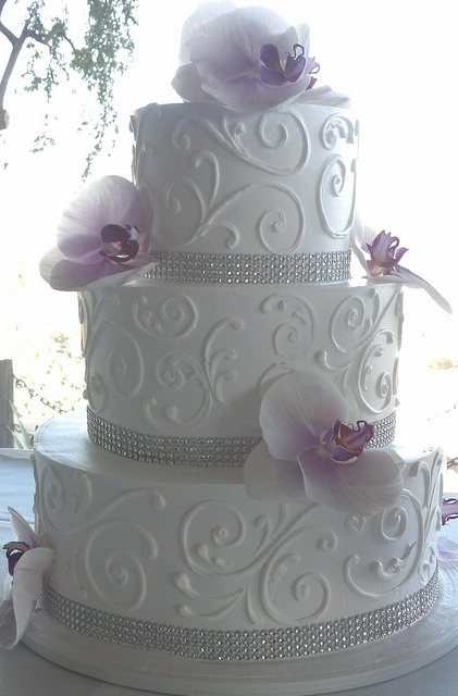 Bling Wedding Cake with Purple Flowers