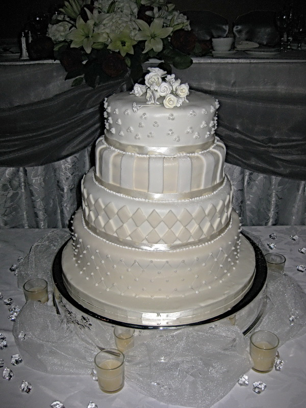 Ivory Four Tier Wedding Cake