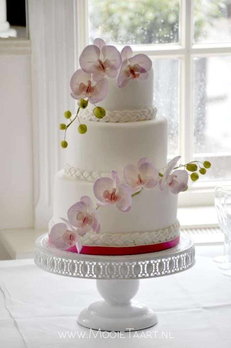 White Wedding Cake with Orchids