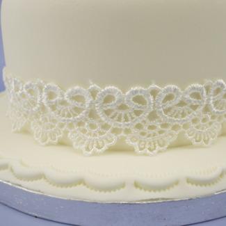 Ivory Lace Wedding Cake with Ribbon