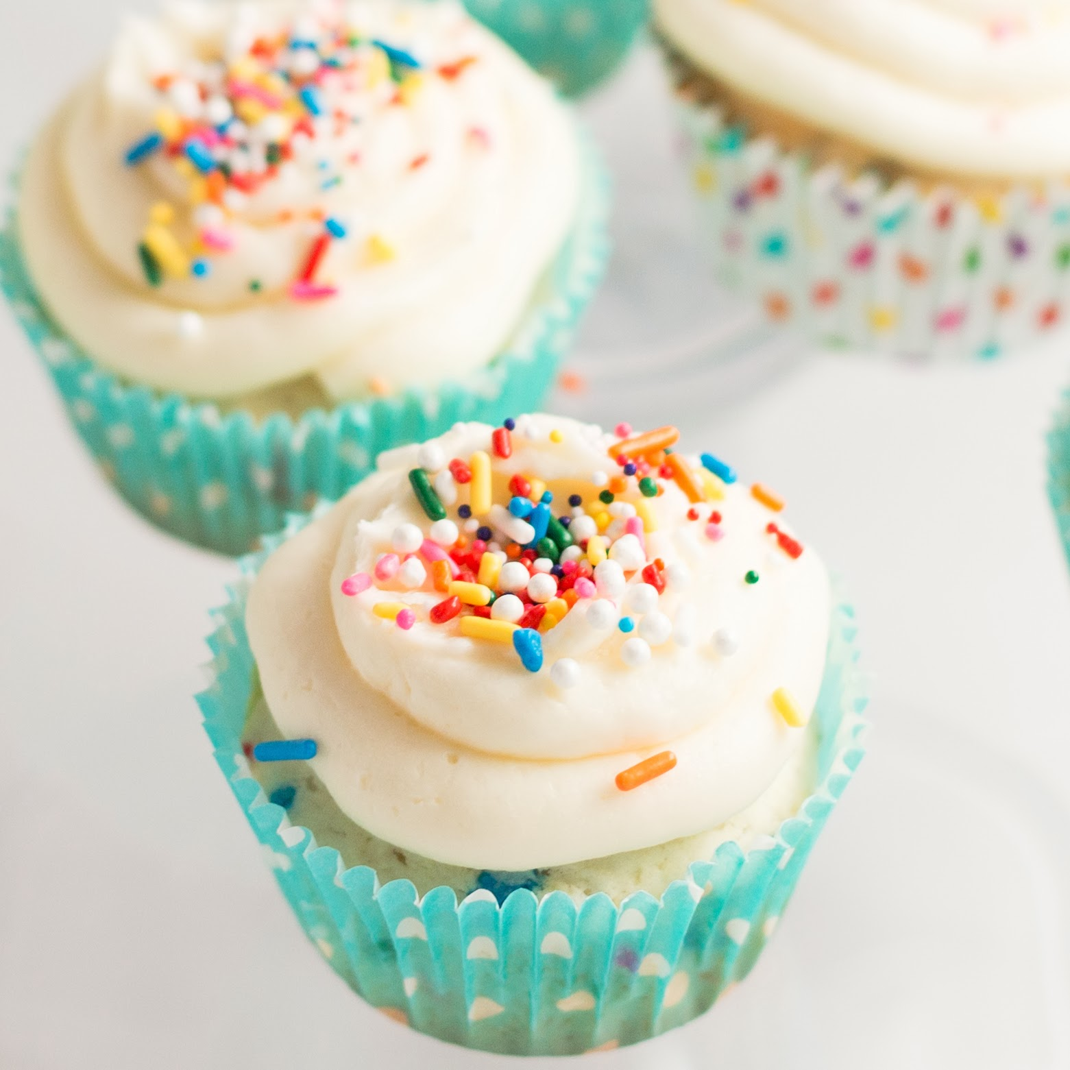 Vanilla Cupcakes with Frosting and Sprinkles