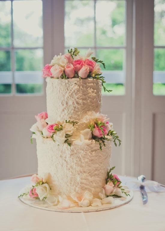 White Wedding Cake with Pastel Pink