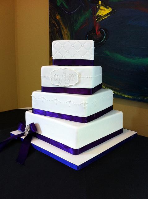 White Wedding Cake with Purple Ribbon
