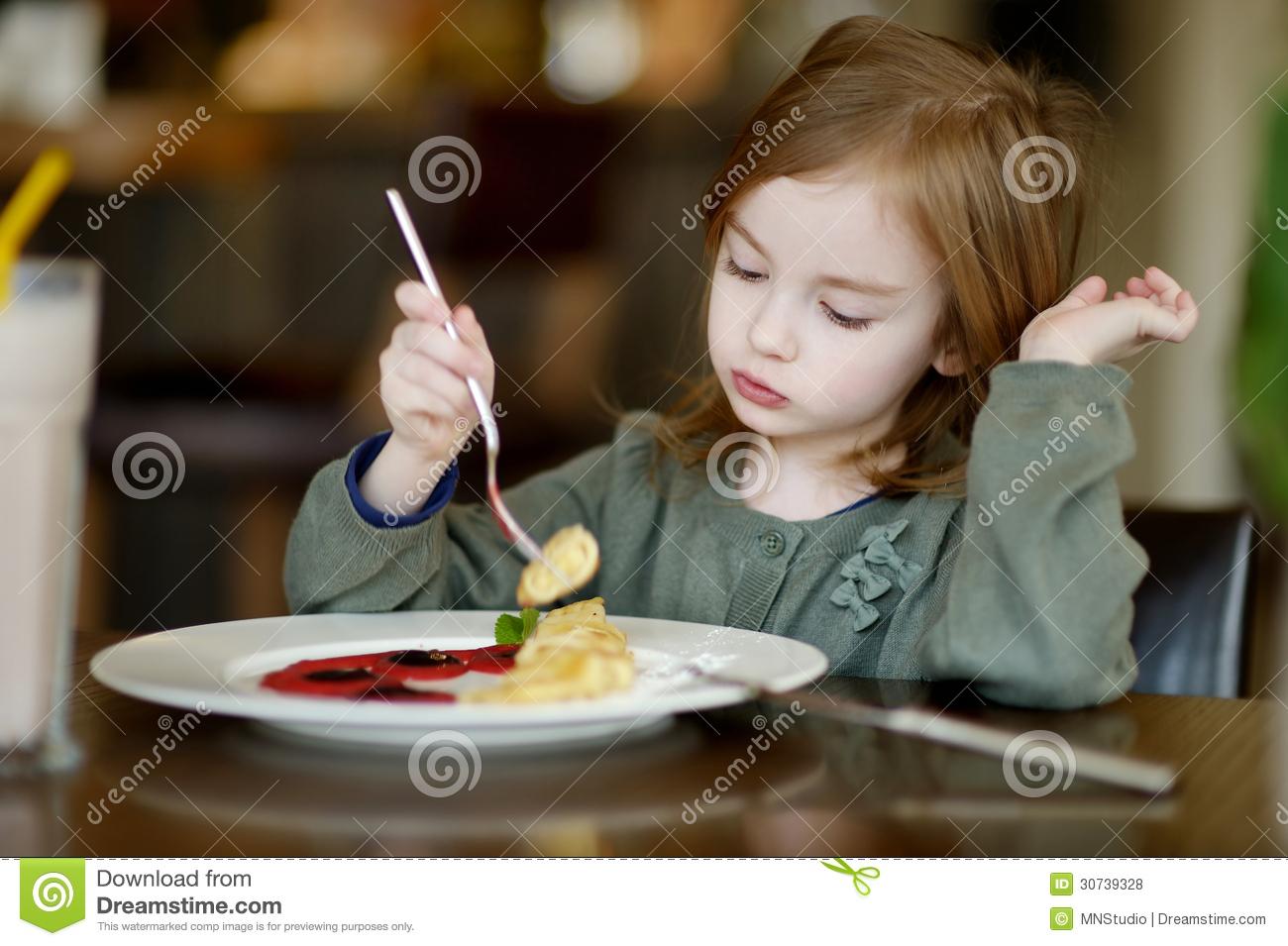 Little Girl Eating Pancakes