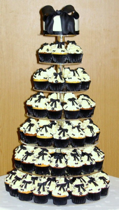 Black and Gold Wedding Cake with Cupcakes