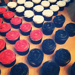 Red and Black Wedding Cake with Cupcakes