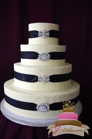 Wedding Cake with Ribbon and Brooches