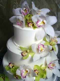 White Buttercream Wedding Cake with Orchids